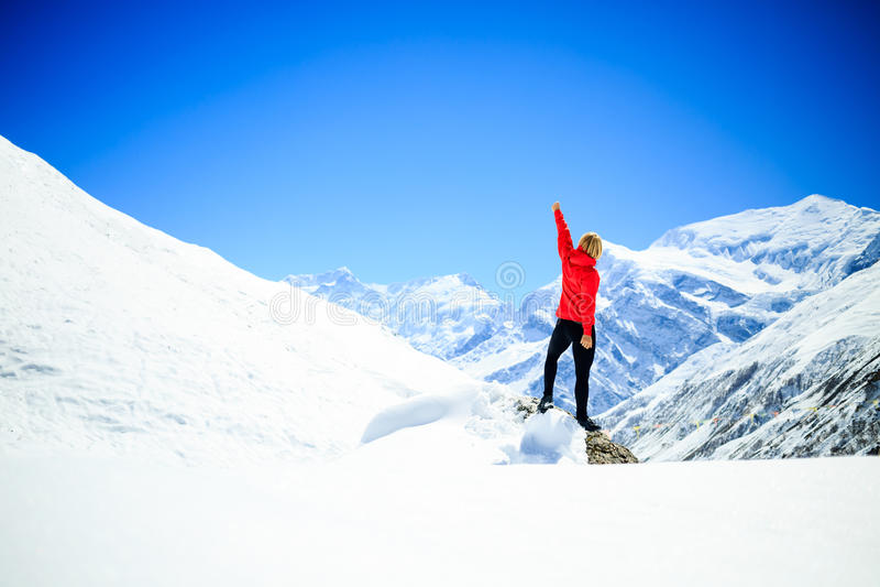 Woman success climbing on mountain peak royalty free stock images