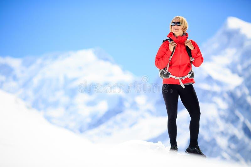 Woman success portrait on mountain peak royalty free stock photography