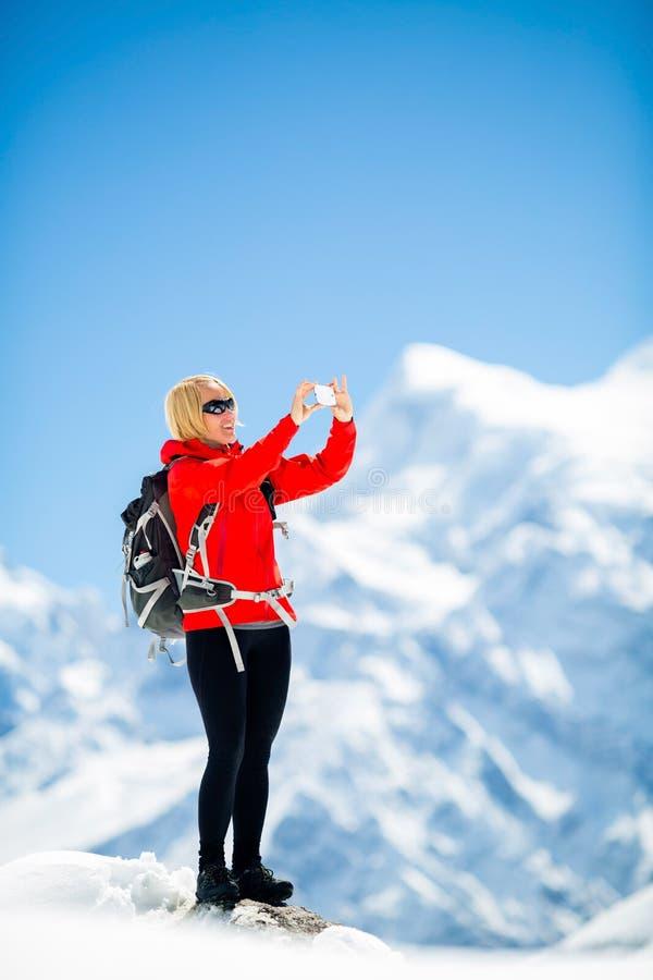 Woman success selfie on mountain peak royalty free stock images