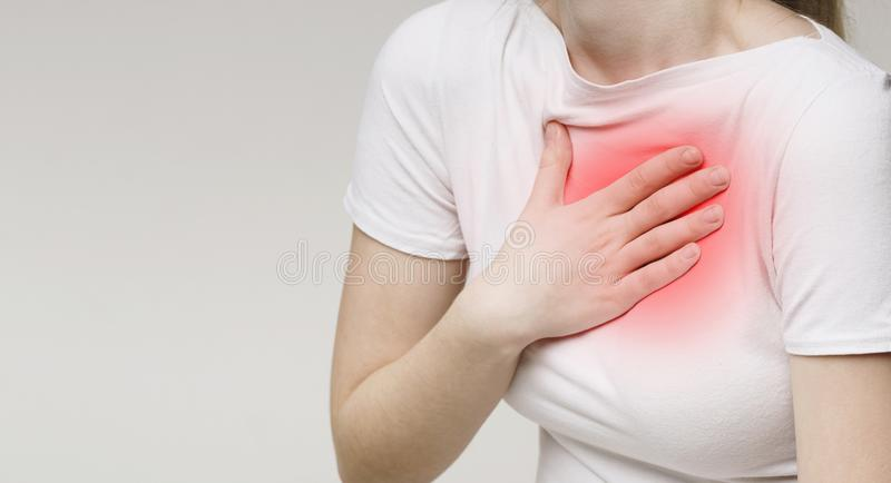 Woman suffering from acid reflux or heartburn royalty free stock image