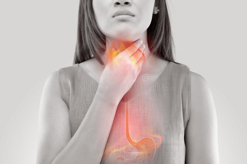 Woman Suffering From Acid Reflux. Or Heartburn- On White Background stock photo
