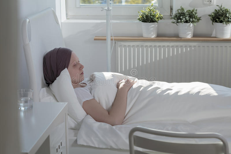 Woman suffering from cancer stock image