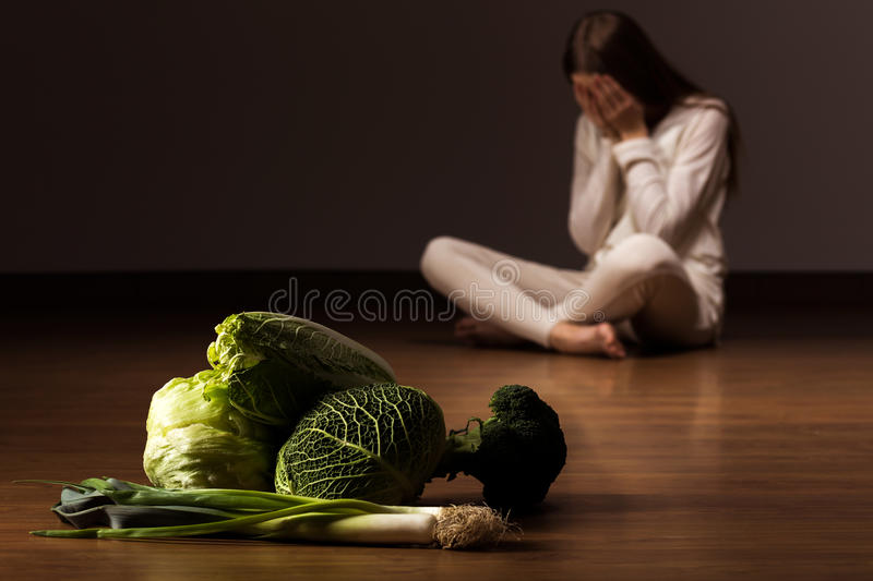 Woman suffering from eating disorder stock photography