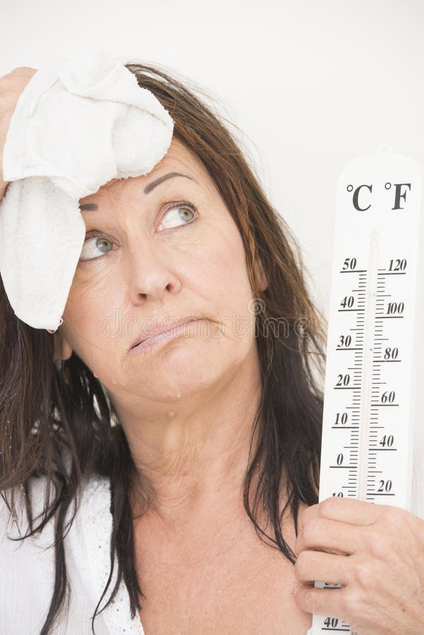 Woman suffering from hot temperatures royalty free stock images