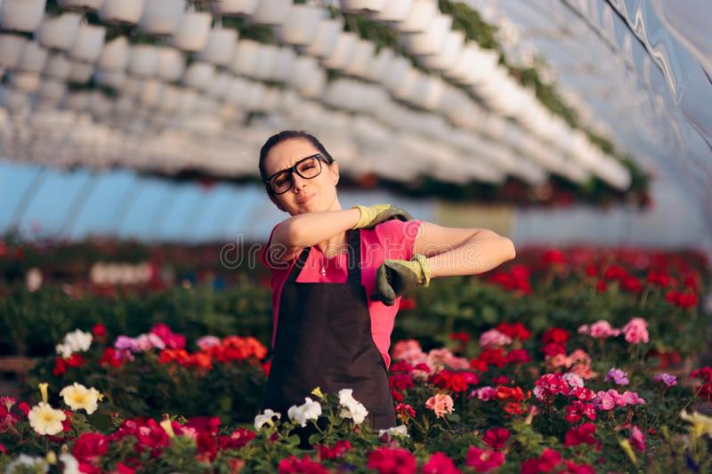 Woman Suffering Injuries While Working in Floral Greenhouse stock photo