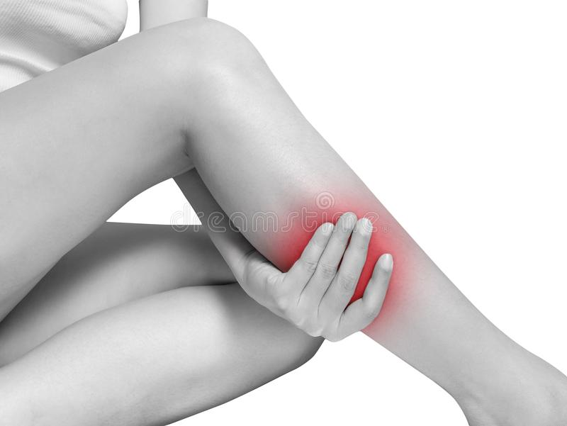 Woman suffering from leg pain, calf pain. mono tone red highlight. Woman suffering from leg pain, calf pain. mono tone highlight at calf, leg isolated on white stock image