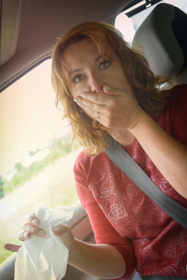 Woman suffering from motion sickness stock photo