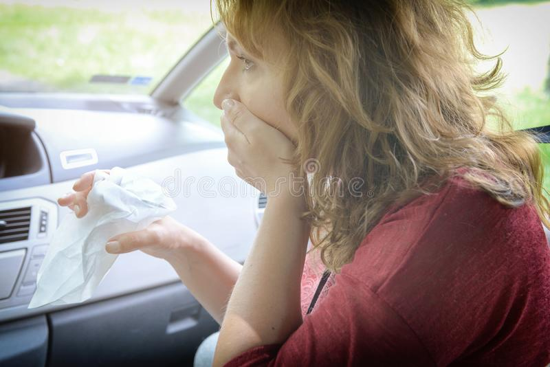 Woman suffering from motion sickness royalty free stock photography