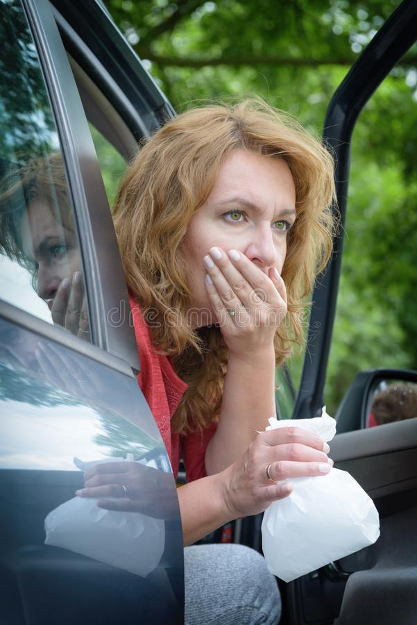 Woman suffering from motion sickness royalty free stock images