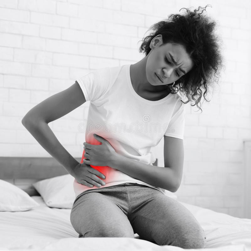 Woman Suffering From Pain In Liver, Touching Right Side stock photo