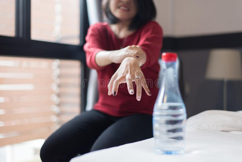 Woman suffering with parkinson disease symptoms,Selective focus. Women suffering with parkinson disease symptoms,Selective focus stock images