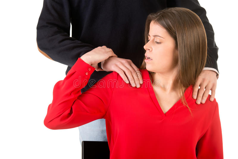 Woman Suffering From Sexual Harassment. In the workplace stock images