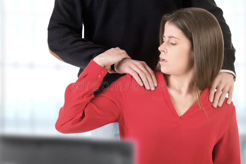 Woman Suffering From Sexual Harassment. In the workplace stock photos