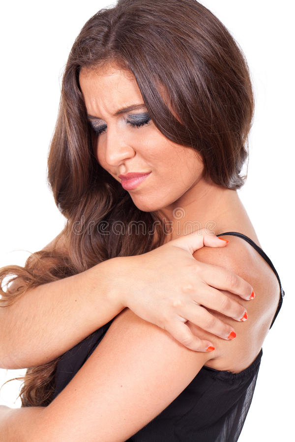 Woman suffering from shoulder pain stock photo