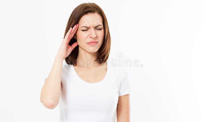 Woman suffering from stress or headache grimacing in pain as she holds the back her neck with her other hand to her temple. On white background stock images
