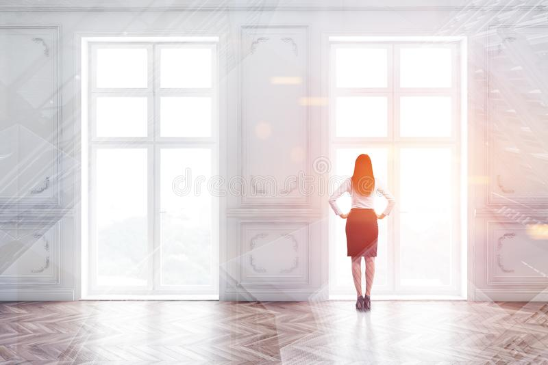 Woman in suit in empty room with windows stock photography