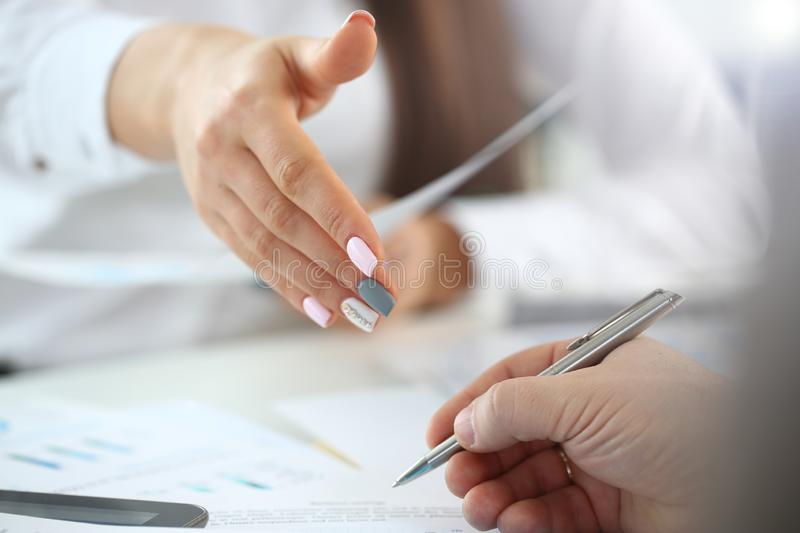 Woman in suit give hand as hello in office closeup stock photo