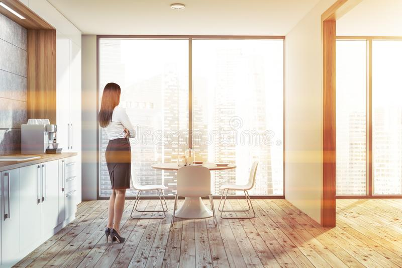 Woman in suit in panoramic kitchen stock image