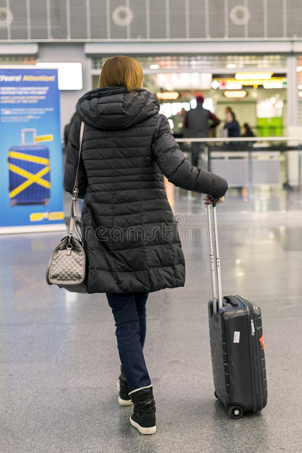 Woman with a suitcase at the airport. Selected focus.  stock photos