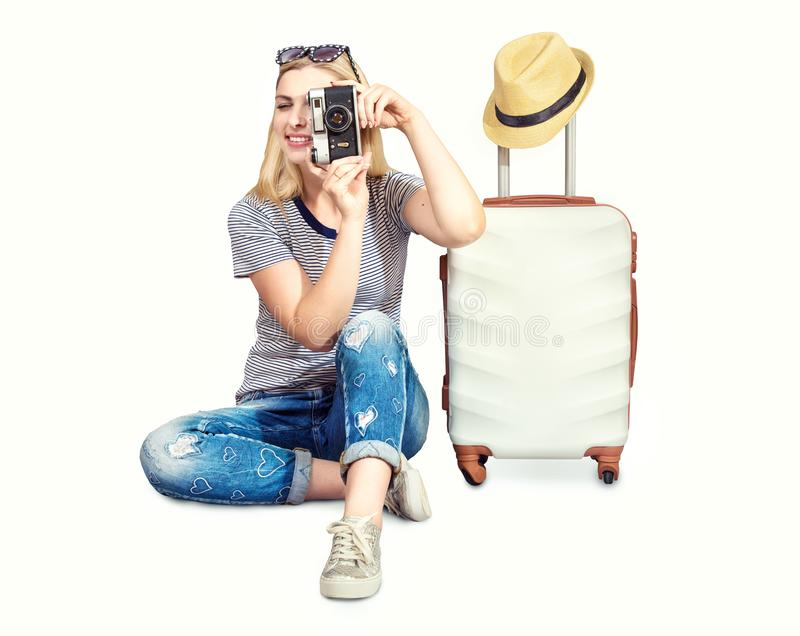 A woman with a suitcase and camera goes on a travel. royalty free stock images