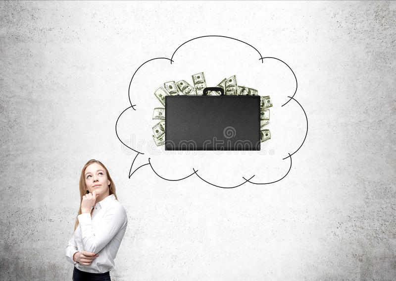 Woman and suitcase with dollars royalty free stock images