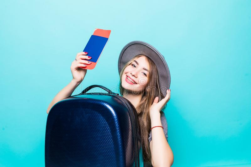 Woman with suitcase and passport running on blue color background. Woman with suitcase and passport running on color background royalty free stock photography