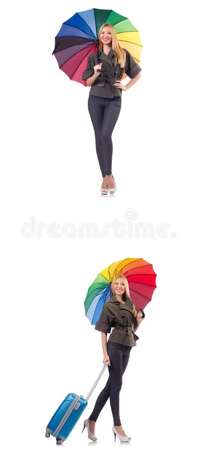 Woman with suitcase and umbrella isolated on white royalty free stock image