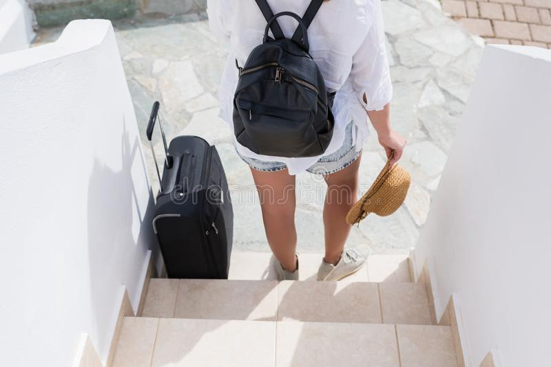 Woman with suitcase waiting the owners of the apartment for check - in. Individual traveler. Woman with suitcase waiting the owners of the apartment for check stock photo