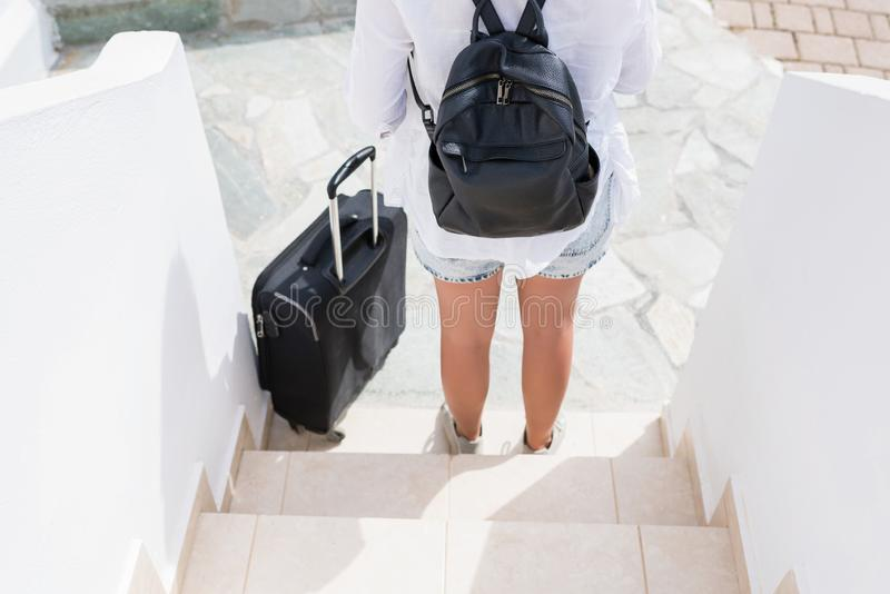 Woman with suitcase waiting the taxi. Individual traveler.  royalty free stock photo