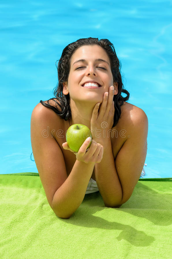 Woman summer diet at pool royalty free stock photo