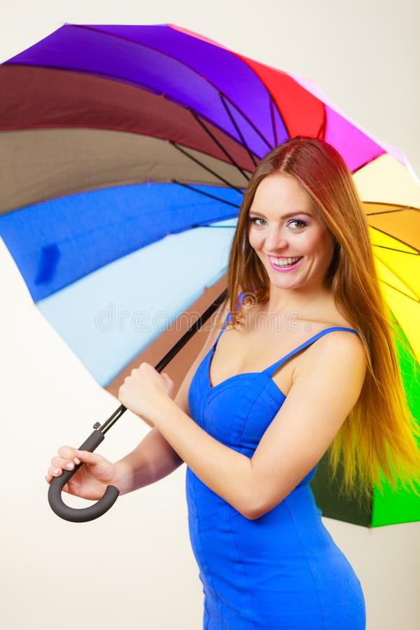 Woman in summer dress holds colorful umbrella royalty free stock photography