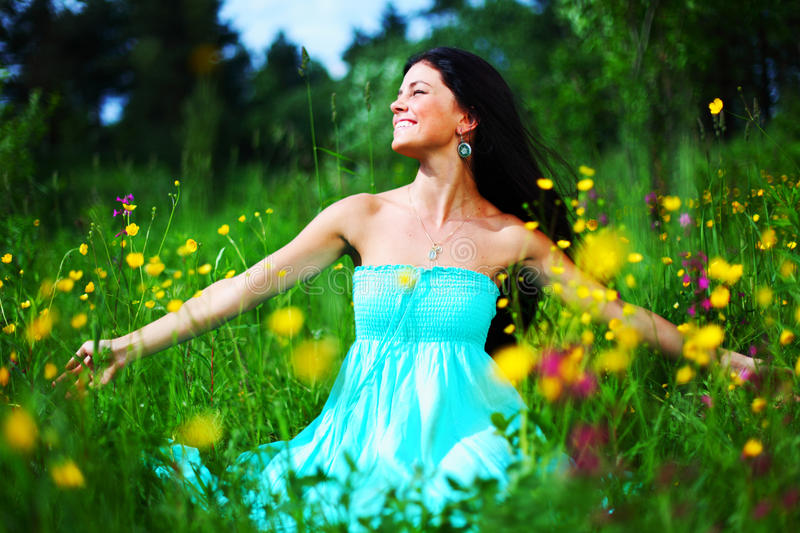 Woman on summer flower field royalty free stock images