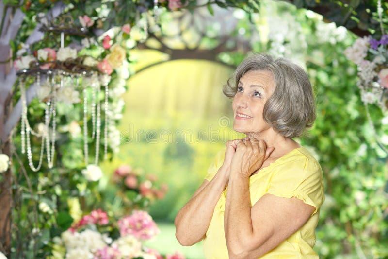 Woman in summer garden stock images