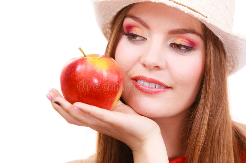 Woman summer hat colorful makeup holds apple fruit stock images