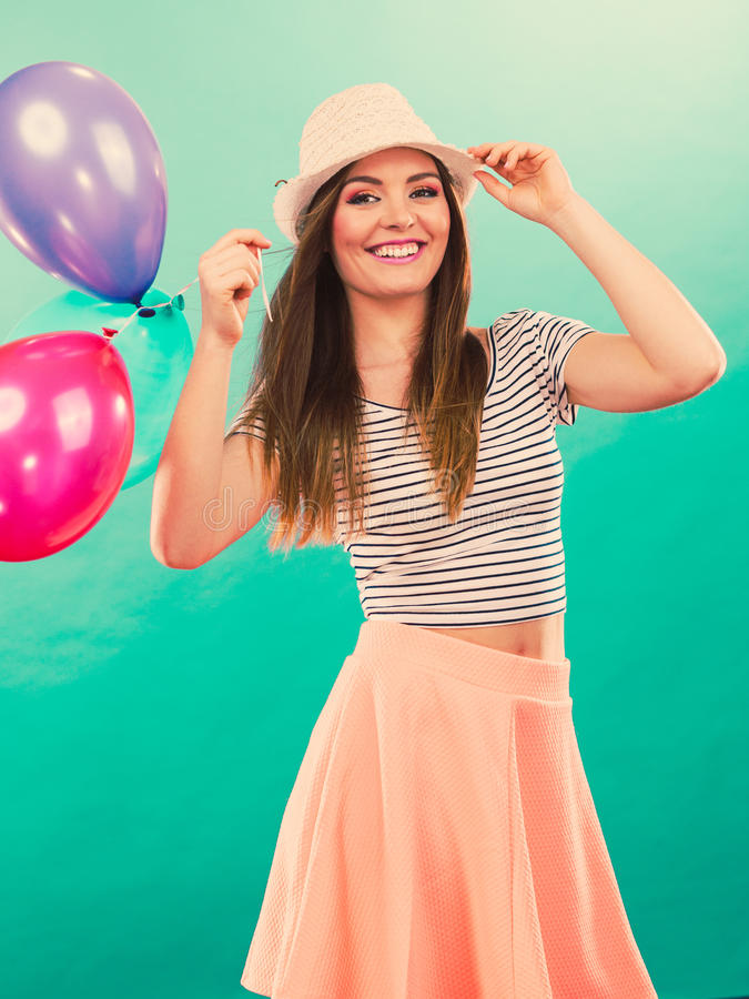 Woman summer joyful girl with colorful balloons royalty free stock photo