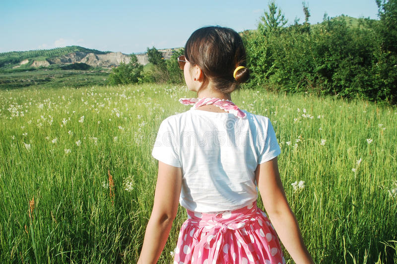 Woman in summer meadow stock image