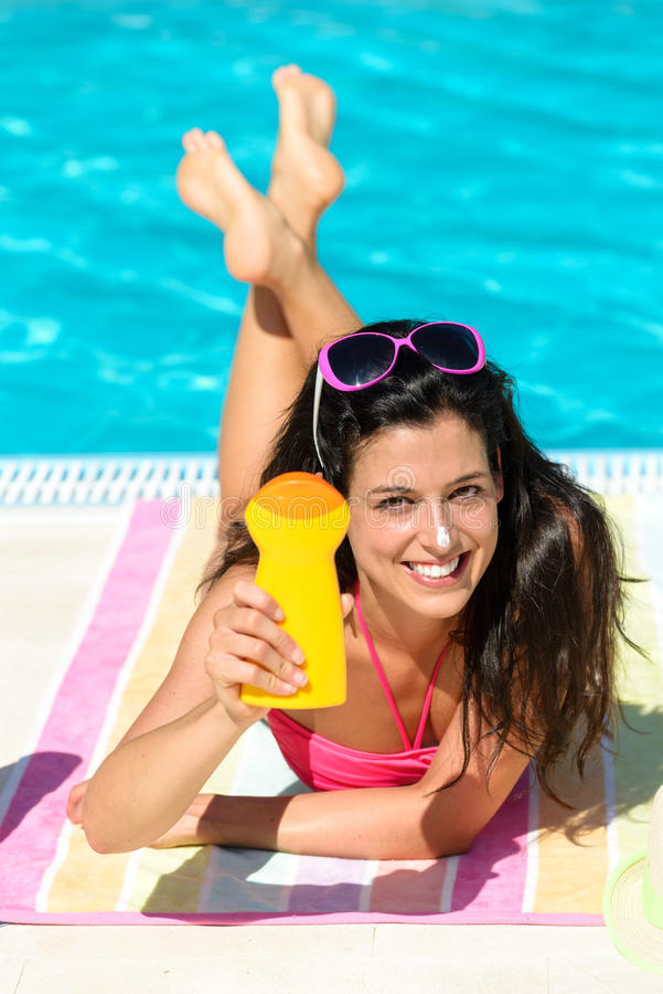 Woman summer sunbathing and suntan lotion royalty free stock photography