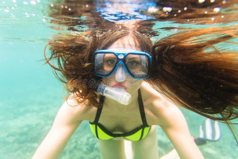 Woman in summer vacation snorkeling in ocean stock images
