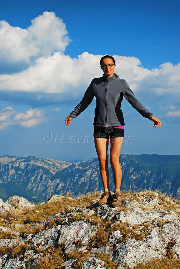 Woman on summit royalty free stock photography