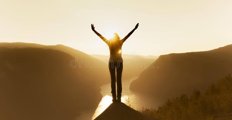 Woman at the summit stock photography