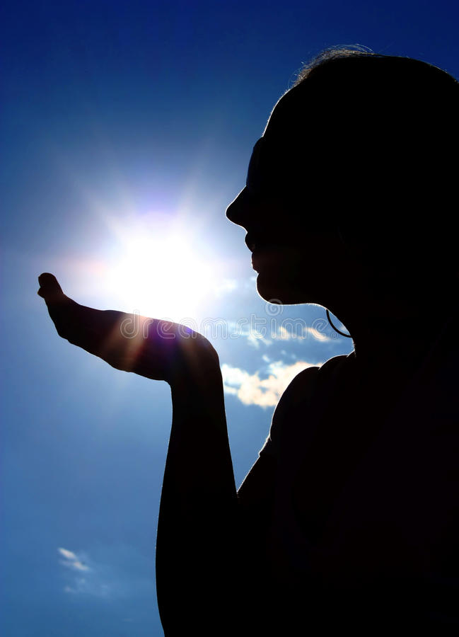 Woman with sun. Woman take the sun in hand royalty free stock photo