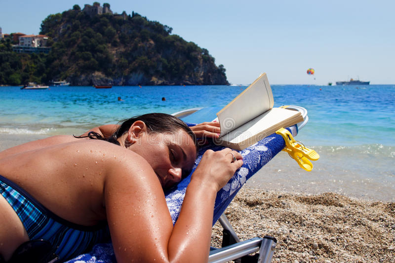 Woman on the sun bed. royalty free stock photography