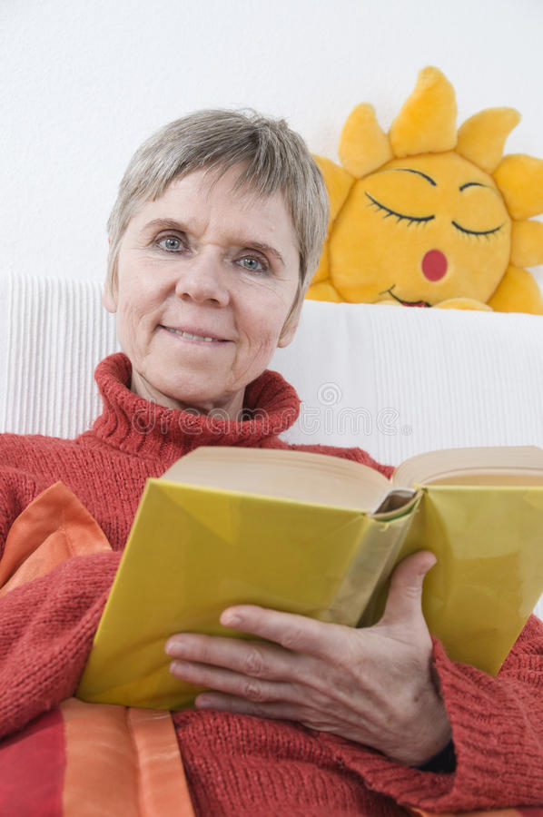 Woman Sun And Book Stock Photography