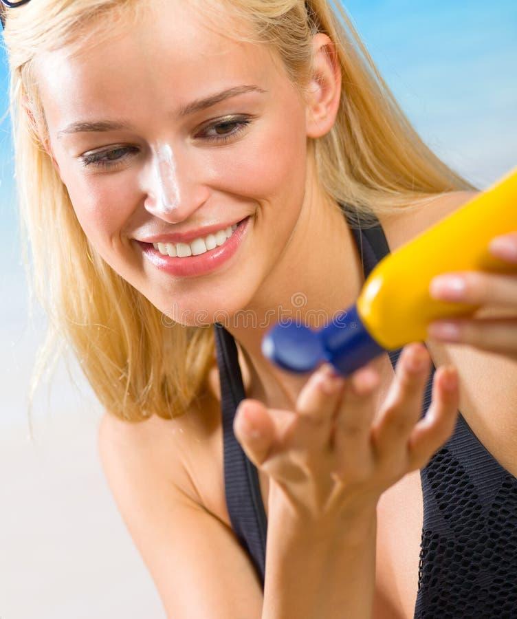 Woman with sun-protection cream stock photos