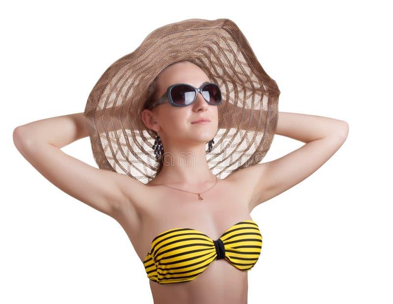 Woman sunbathes on the sun stock photos