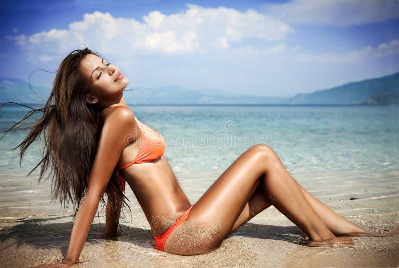 Woman sunbathing royalty free stock photo