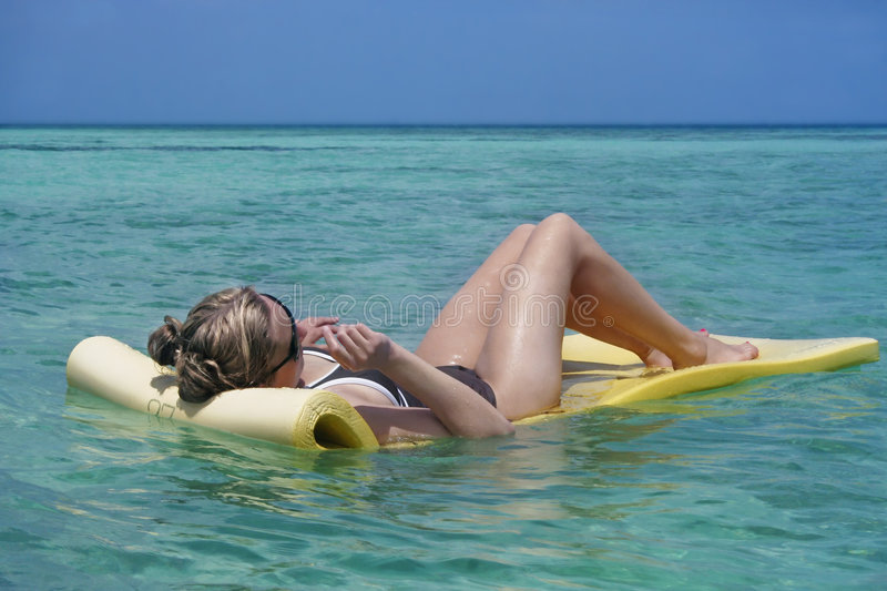 Woman Sunbathing royalty free stock images