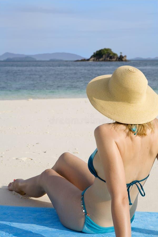 A woman sunbathing royalty free stock photography