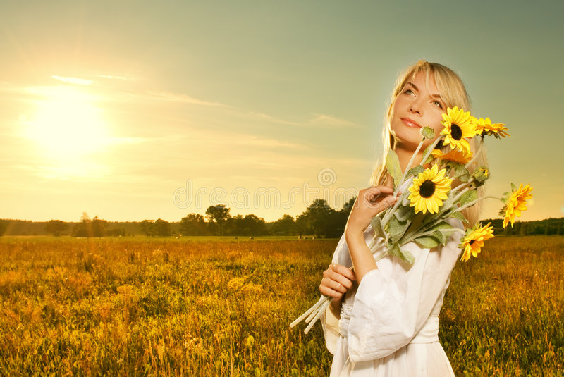 Woman with a sunflowers stock images