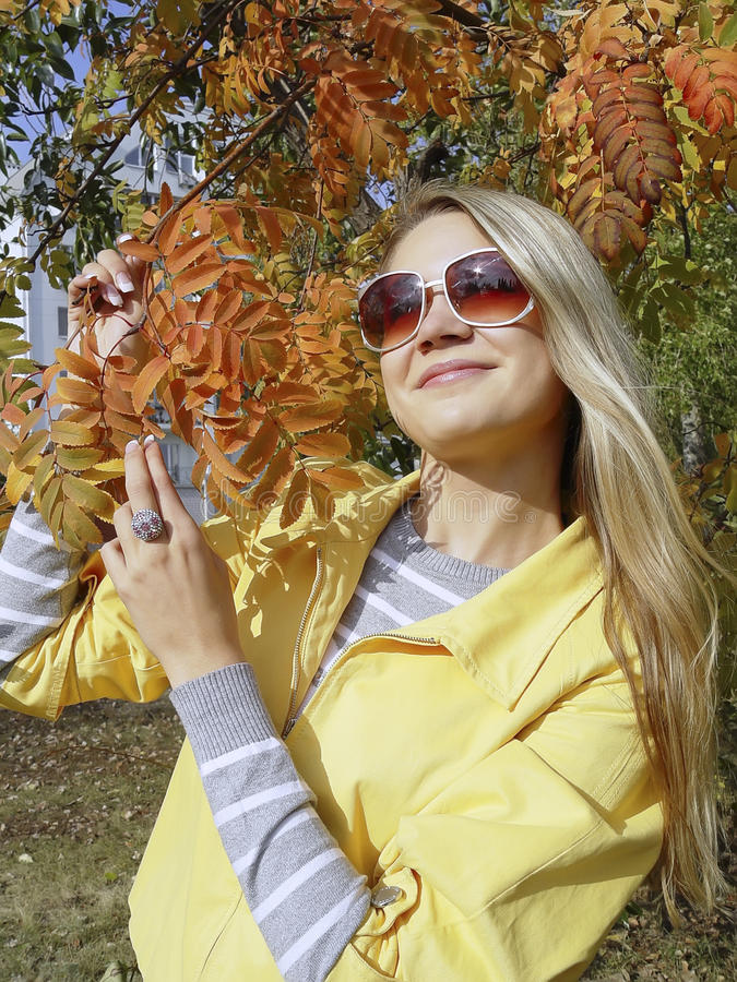 Woman in sunglasses with ash fall stock photos